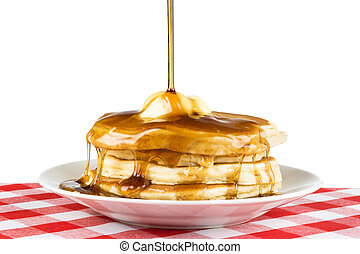 Breakfast pancakes and syrup - Sweet maple syrup being...