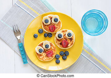 Breakfast pancakes for kids. Funny cute animal shaped pancakes