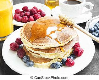 Breakfast Pancakes with Honey Flowing,Coffee and Berries