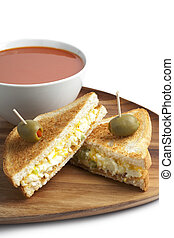 breakfast sandwich with egg salad and tomato soup