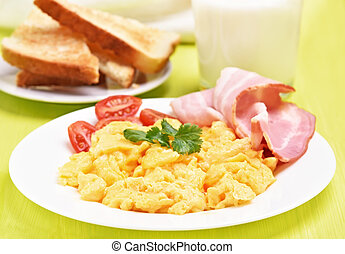 Breakfast scrambled eggs with bacon and tomatoes
