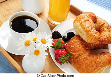 Breakfast served on a tray on a sunny morning