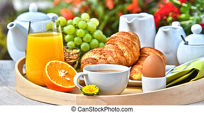 Breakfast served with coffee, juice, croissants and fruits -...