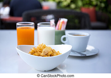 Breakfast set with cornflakes and cup of coffee