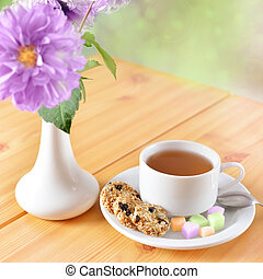 Breakfast still life. Cookies with cup of tea