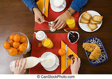 breakfast - healthy living: young girl having breakfast at...