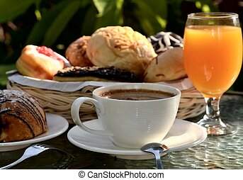 Breakfast table scene illuminated with morning light. ...
