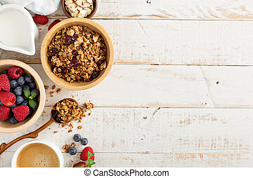 Breakfast table with granola and fresh berries