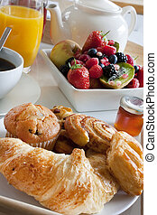 breakfast treat with fruit and pastries - pastries, tea,...