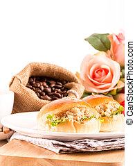 breakfast tuna sandwich and coffee