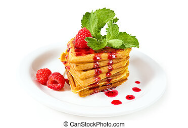 breakfast - waffles with syrup, mint and raspberries