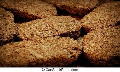 Breakfast Wheat Bricks Rotating - Pile of cereal bricks...
