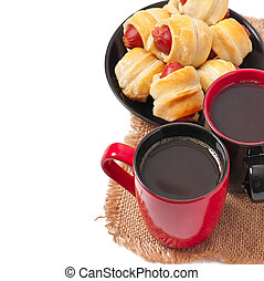 cup of coffee and sausage rolls