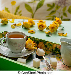 Breakfast with a cup of tea on a tray