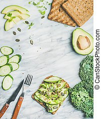 Breakfast with avocado, cucumber, kale, kress sprouts,...