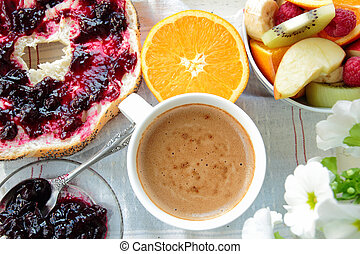 Breakfast with bread with currant jam, coffee and fruits