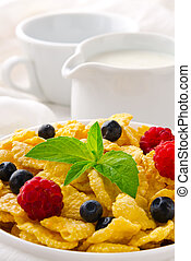 Breakfast with cereal flakes, berries, mint and milk