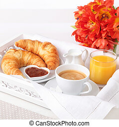 Breakfast with coffee, orange juice and croissant