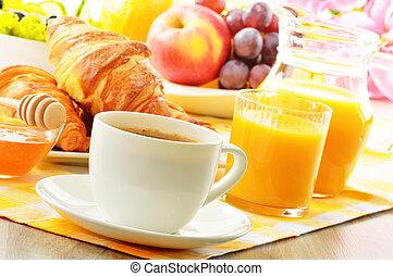 Breakfast with coffee, orange juice, croissant, egg,...