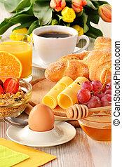 Breakfast with coffee, rolls, egg, orange juice, muesli and cheese