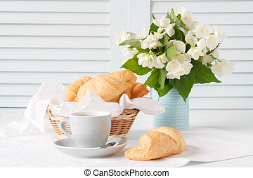 Breakfast with croisant and coffee