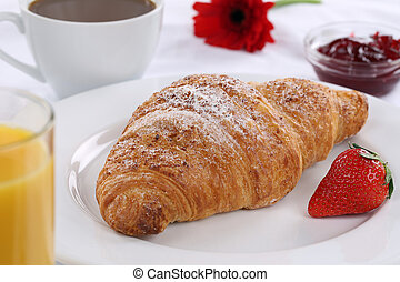 Breakfast with croissant, coffee and marmalade