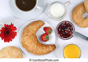 Breakfast with croissant, coffee and orange juice from above