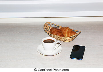 Breakfast with croissant, with coffee and with telephone