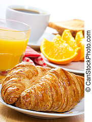 breakfast with croissants, juice and coffee