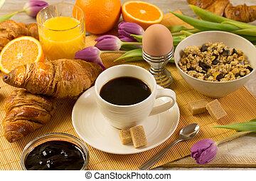 breakfast with croissants, orange juice and coffee