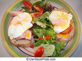 Breakfast with eggs Benedict , toasted ham, poached eggs.