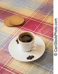 Breakfast with espresso coffee and biscuits
