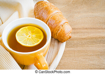 Breakfast with fresh croissants and cup of tea