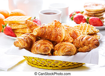 breakfast with fresh croissants, berries and fruits