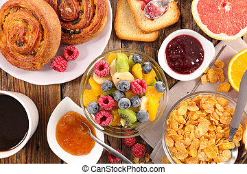 breakfast with fruit, croissant, cereal and coffee