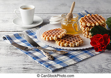 Breakfast with homemade wafers and honey