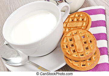 milk - breakfast with milk and biscuits on the wood table