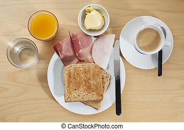 Breakfast with orange juice, coffee, toast