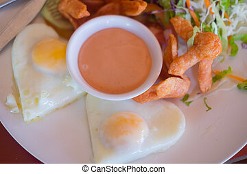 Breakfast with over easy egg and hotdog - Delicious ...