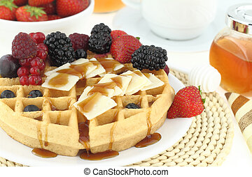 Breakfast with waffle and fruits