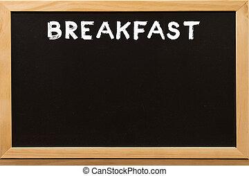Breakfast write by white chalk on a blackboard.