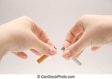 NO SMOKING ! - Breaking a cigarette. NO SMOKING !
