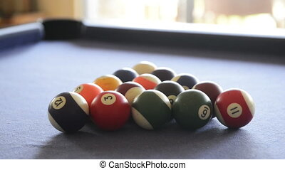 Footage of billiard balls break on a pool table at start of a game in high definition with audio