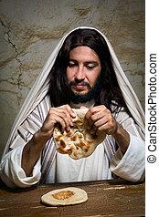 Breaking bread at Last Supper