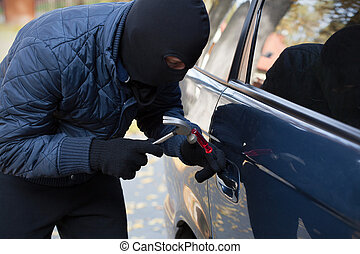 Breaking into a car with hammer