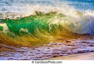 breaking ocean wave at sunset - beautiful ocean wave at ...
