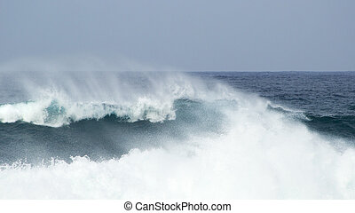 breaking ocean waves - powerful ocean waves breaking by the...