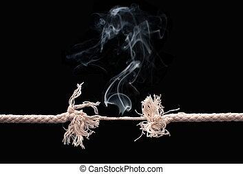 Breaking rope - Burning rope on the verge of breaking into...