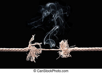 Breaking rope - Burning rope on the verge of breaking into...