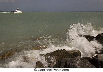 Breaking Waves - Waves break agaisnt the rocky shore in Key ...